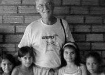 Man standing with young children around him