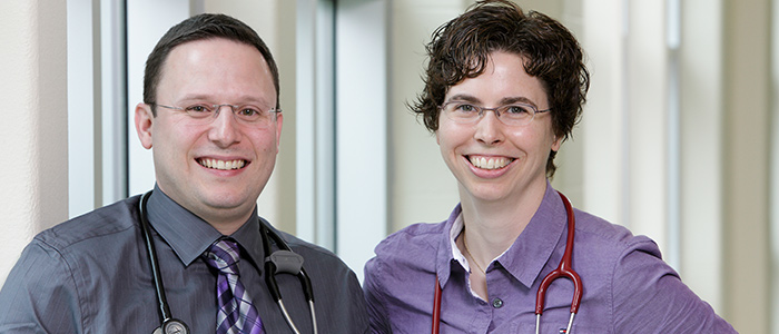 Male and Female from family medicine standing with a stethoscope around their neck