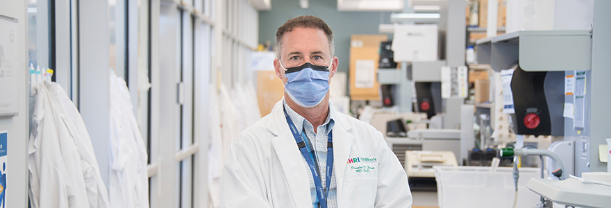 Dr. Doug Fraser wearing a mask in his lab