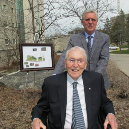Dr. Henry Barnett and his son William in front of the design for the new garden